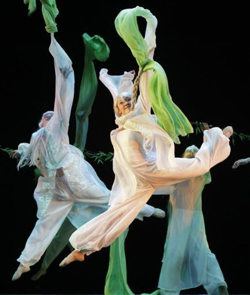"""Members of the China Jinling Dance Company on Nanjing perform during a dress rehearsal for """"The Peony Pavilion,"""" which opens Jan 5-8 at Lincoln Center in New York, Thursday, Jan. 5, 2012. This is the first time the company is performing outside China. """"The Peony Pavilion,"""" first performed as an opera in 1598 during the Ming dynasty, tells a story about forbidden love. (AP Photo/Kathy Willens)"""