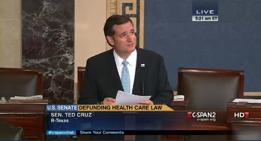 In an image made from the C-Span broadcast Senator Ted Cruz continues to speak on the floor of the U.S. Senate at 5:21 a.m. EDT Wednesday Sept. 25, 2013. Since Tuesday afternoon, Cruz _ with occasional remarks by Sen. Mike Lee, R-Utah, and other GOP conservatives _ have controlled the Senate floor