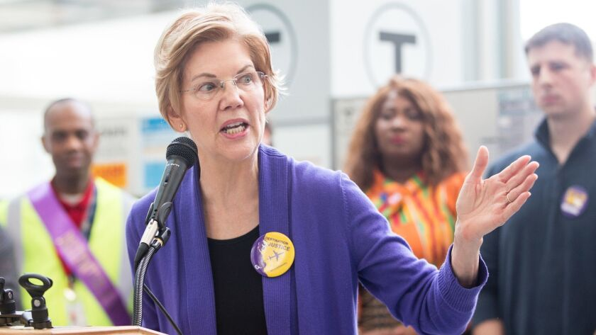Sen. Elizabeth Warren (D-Mass.) speaks during a rally for airport workers affected by the government shutdown at Boston Logan International Airport on Jan. 21.