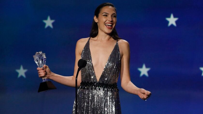 """Wonder Woman's"" Gal Godot accepts the #SeeHer Award, given to an honoree ""who embodies the values set forth by the #SeeHer movement"" during the 23rd Critics' Choice Awards."