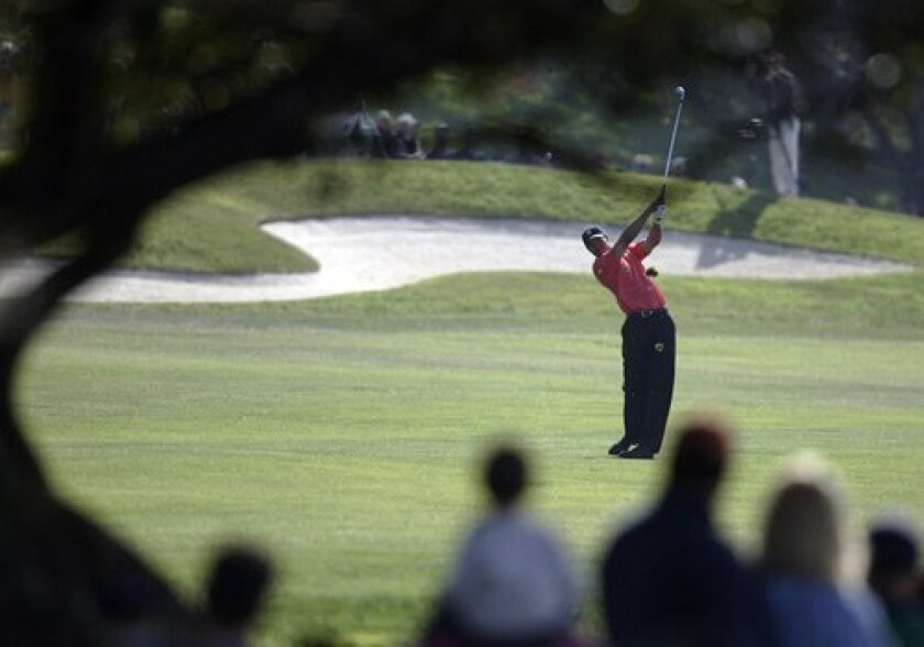 Tiger Woods on the fourth fairway, headed to his fourth Buick win at Torrey, 2006.