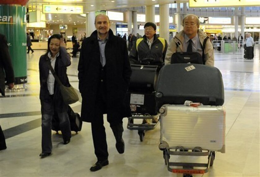 U.N. nuclear inspectors, headed by Herman Nackaerts, second left, arrive at Vienna's Schwechat airport, Thursday, Oct. 29, 2009. U.N. nuclear inspectors have returned from an inspection of a previously secret Iranian uranium enrichment site.(AP Photo/Hans Punz)