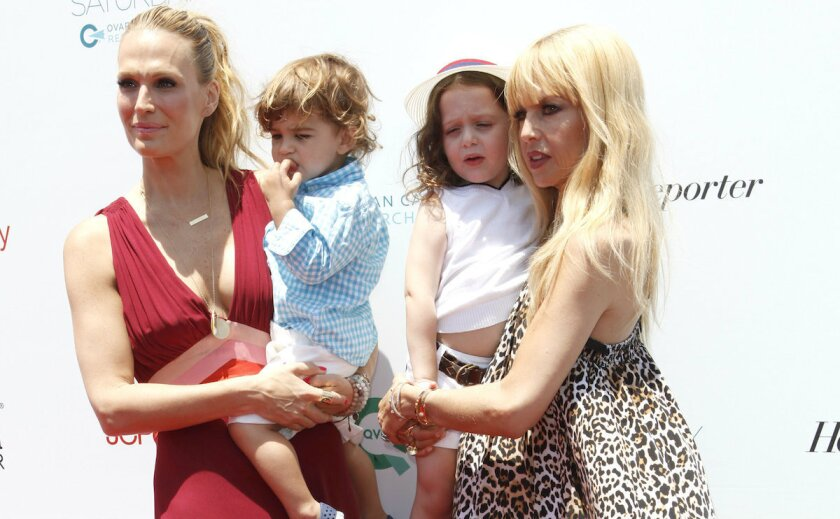 Event cohosts Molly Sims, left (with son Brooks), and Rachel Zoe (with son Skyler) on the red carpet at last year's Super Saturday L.A. fundraiser in Santa Monica. Sims and Zoe will return as hosts this year.
