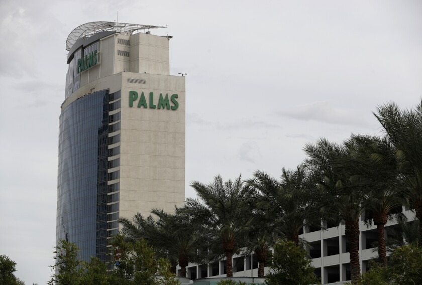 FILE - In this Oct. 1, 2018, file photo, trees line the Palms Casino Resort in Las Vegas. The purchase by a California-based Native American tribe of a casino resort just off the Las Vegas Strip is being seen as a milestone in the evolution of Indian casinos in the city at the center of U.S. gambling. The San Manuel Band of Mission Indians announced recently it will buy the Palms Casino Resort for $650 million. (AP Photo/John Locher, File)