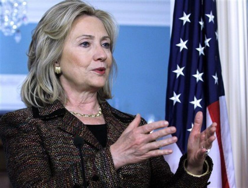 Secretary of State Hillary Rodham Clinton, accompanied by Czech Foreign Minister Karel Schwarzberg, not shown gestures during their joint news confernece at the State Department in Washington, Thursday, June 2, 2011. (AP Photo/Jose Luis Magana)