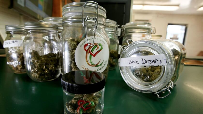 Marijuana in jars at MED X, a pot dispensary on Century Boulevard in South L.A., on June 27.