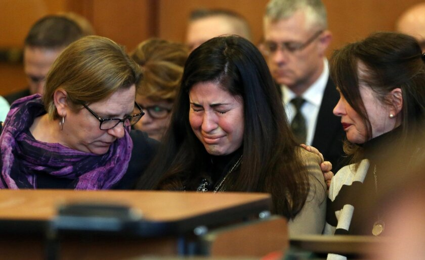Diane Chism, mother of Philip Chism, sobs while being consoled during her son's sentencing in the murder and rape of Colleen Ritzer, an Andover resident and Danvers High School teacher. The sentencing happened in Salem Superior Court, Salem, Mass., Friday, Feb. 26, 2016.  (David Le/The Salem News v