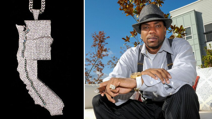 Jevon Lawson, right, wore a diamond pendant with pale green gems mimicing the OxyContin trail from Los Angeles to Washington state.