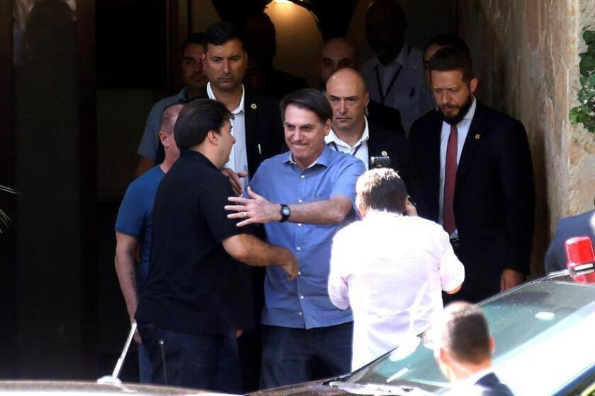 Agencia Brasil provided this photo of Brazilian President Jair Bolsonaro (C) leaving the Brasilia home of the speaker of the lower house of Congress , Rodrigo Maia (L), following a meeting on Saturday, March 16. EFE-EPA/Antonio Cruz/Agencia Brasil/EDITORIAL USE ONLY