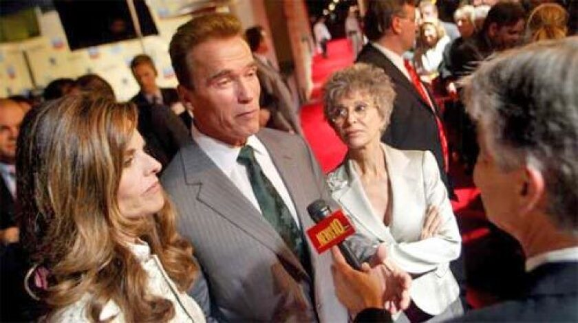 California First Lady Maria Shriver, left, and actress Rita Moreno, right, listens as Governor Schwarzenegger speaks to the press before The California Museum's California Hall of Fame ceremony in Sacramento.