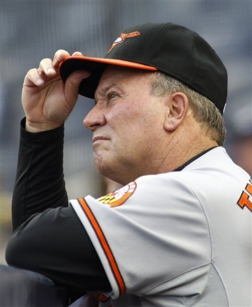 Baltimore Orioles manager Dave Trembley watches his team during the first inning of a baseball game against the New York Yankees at Yankee Stadium in New York, Tuesday, June 1, 2010. The Yankees won 3-1. (AP Photo/Paul J. Bereswill)
