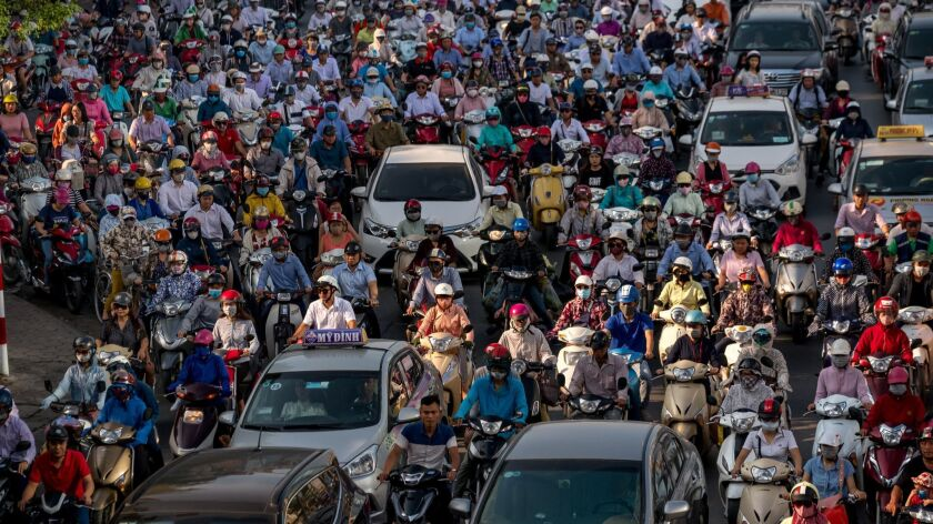 Morning traffic fills a street in Hanoi. Vietnam has a rapidly growing economy and counts the United States as one of its top export markets.