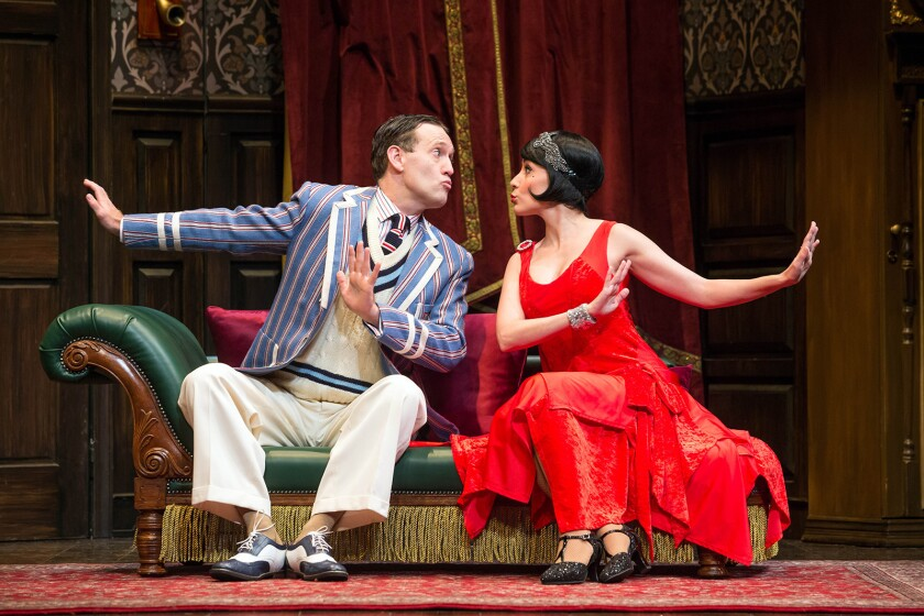 L-R: Ned Noyes and Jamie Ann Romero in the national tour of ?The Play That Goes Wrong.? Written by H