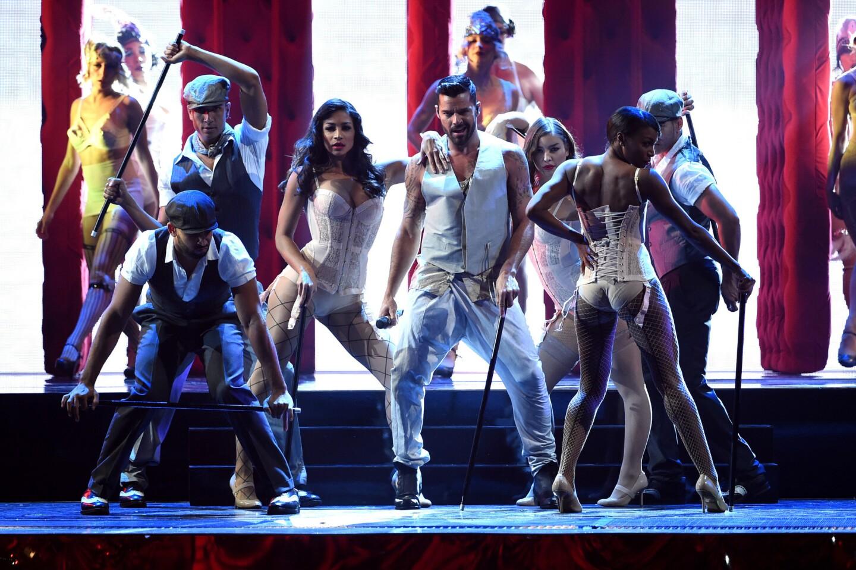 Ricky Martin strikes a pose onstage.