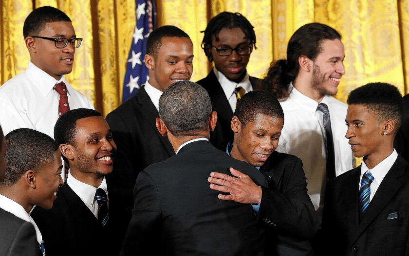 President Obama hugs guests from Chicago as he announces the My Brother's Keeper initiative, designed to help young black and Latino men.