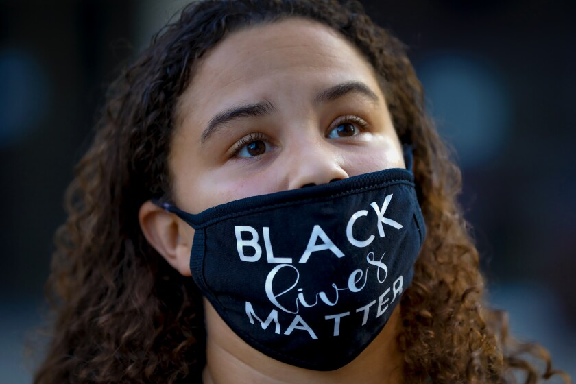 Mattique Gray from Serra Mesa was among demonstrators who gathered at the San Diego Civic Center in November