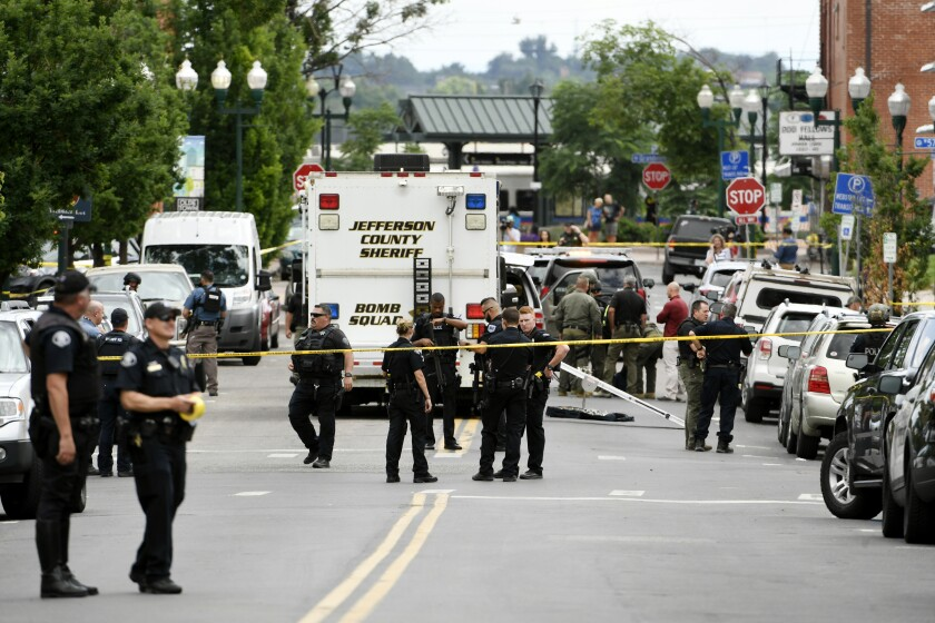 Police officers investigate the scene of an early afternoon shooting in Olde Town Arvada on Monday, June 21, 2021 in Arvada, Colo. Authorities say a gunman is believed to have shot and killed an officer and another person in a shopping district in a Denver suburb before being fatally shot by police. Police say an officer responded to a call about a suspicious incident Monday near the library in the city of Arvada, and about 15 minutes later, a 911 call came in about shots fired and the officer hit. (Helen H. Richardson/The Denver Post via AP)
