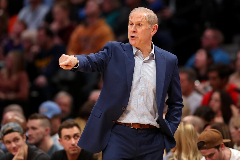 Cavaliers coach John Beilein calls out instructions to his players during a game against the Nuggets on Jan. 11 at the Pepsi Center.