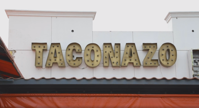 Taconazo serves traditional Tijuana-style tacos, each finished with a dollop of guacamole.