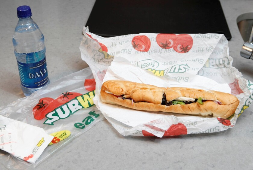 A Subway executive said that an ingredient used in the production of yoga mats would be removed from all of its bread in a week. Above, a 2009 file photo shows a Subway foot-long sandwich.