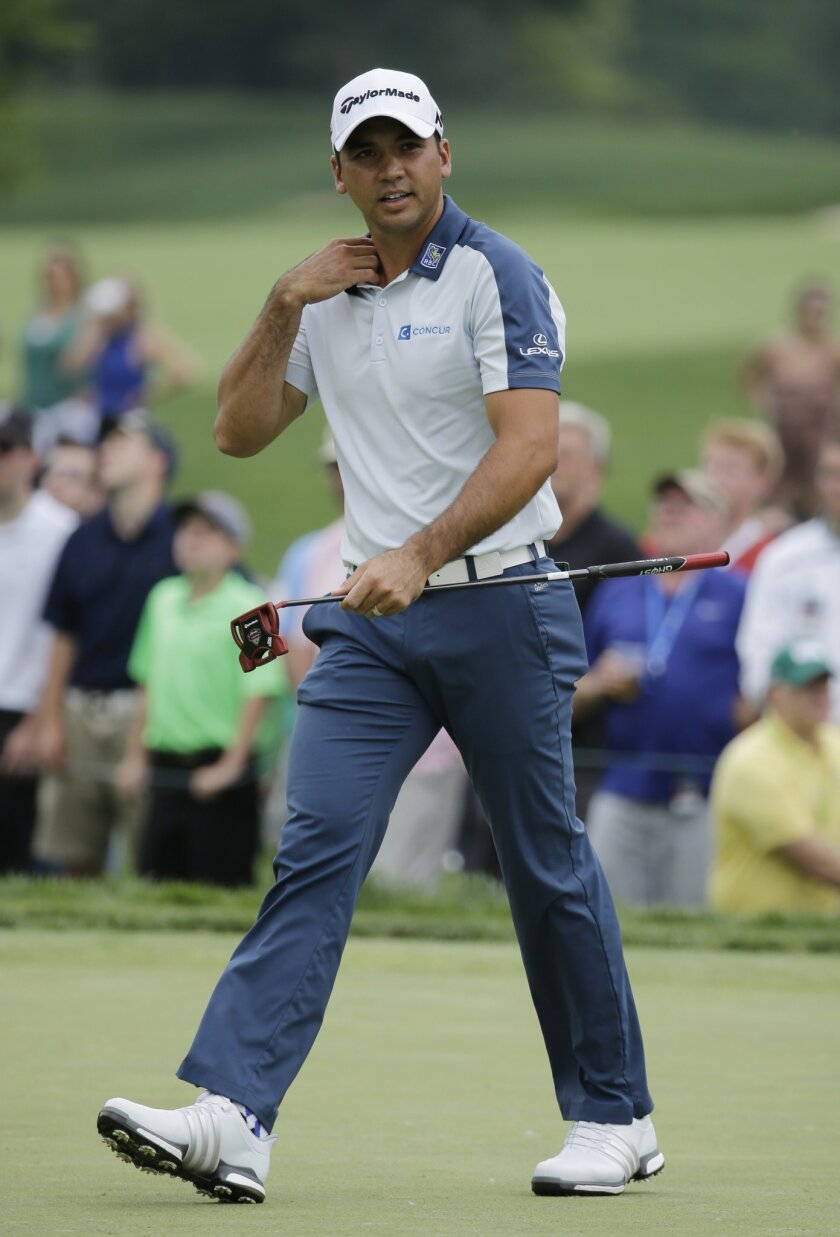 Jason Day, of Australia, reacts to his putt on the ninth green during the third round of the Memorial golf tournament, Saturday, June 4, 2016, in Dublin, Ohio. (AP Photo/Darron Cummings)