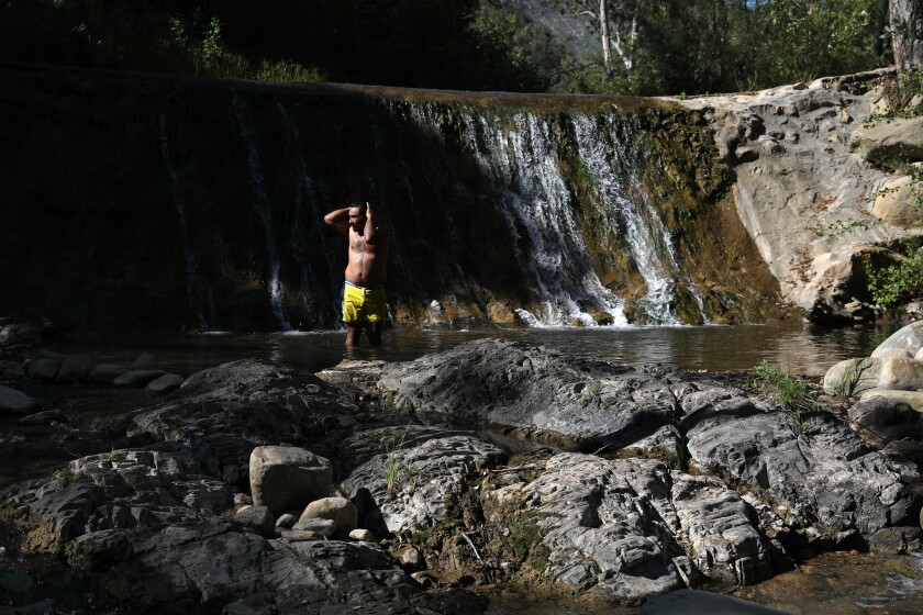 Erick Galdamez of Los Angeles cools off in the North Fork Matilija Creek at Wheeler Gorge Campground.