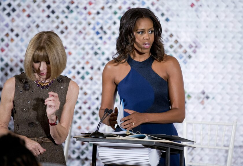 American Vogue editor-in-chief Anna Wintour leaves the stage after introducing first lady Michelle Obama during the Fashion Education Workshop in East Room of the White House in Washington, Wednesday, Oct. 8, 2014.  (AP Photo/Manuel Balce Ceneta)