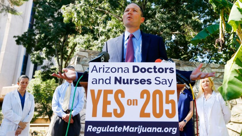 J.P. Holyoak, chair of the Campaign to Regulate Marijuana Like Alcohol, is joined by doctors and nurses at the Arizona capitol to endorse Prop 205, the legalization of marijuana.