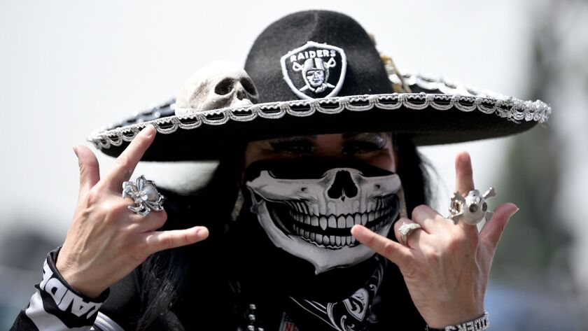 A Oakland Raider fan poses before an NFL preseason football game against the Los Angeles Rams Saturd