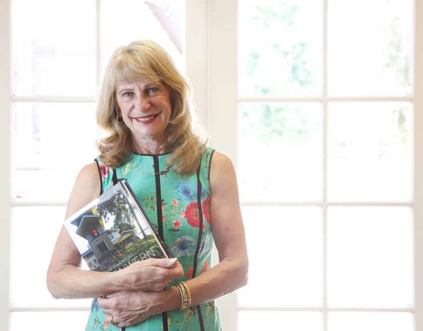 """Sue Major, photographed at her office in Rancho Santa Fe,  holds a copy of the new book she and her husband, John, co-commissioned, """"Frank Lloyd Wright's Penwern: A Summer Estate."""""""