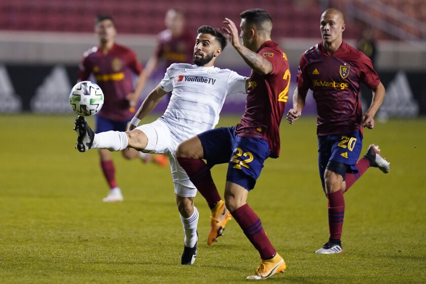 LAFC forward Diego Rossi controls the ball as Real Salt Lake's Aaron Herrera defends on Oct. 4 in Sandy, Utah.