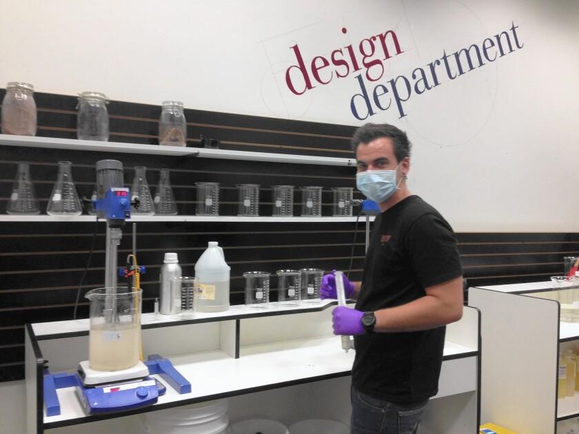 California Vaping Co. founder Dakoda Collins, in his San Diego laboratory, prepares to add liquid nicotine to a batch of e-liquid.