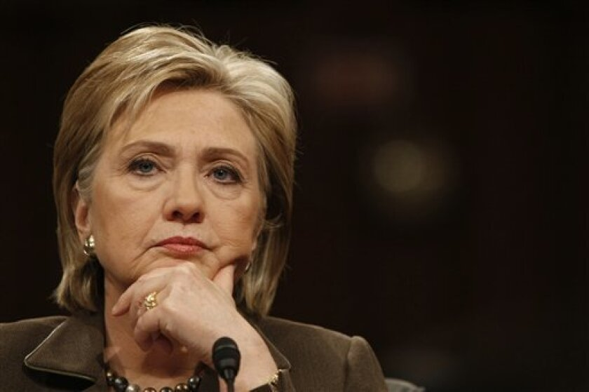 Secretary of State-designate Sen. Hillary Rodham Clinton, D-N.Y., listens on Capitol Hill in Washington, Tuesday, Jan. 13, 2009, while testifying before the Senate Foreign Relations Committee hearing on her nomination. (AP Photo/Gerald Herbert)
