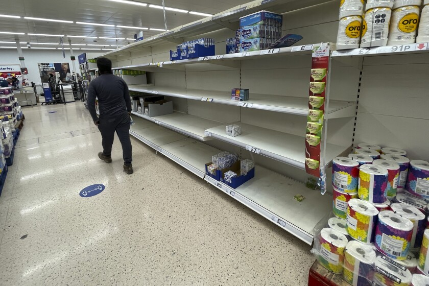 A view of empty shelves at a supermarket in London, Monday, Sept. 20, 2021. Retailers, manufacturers and food suppliers have reported disruptions due to a shortage of truck drivers linked to the pandemic and Britain's departure from the European Union, which has made it harder for many Europeans to work in the U.K. (AP Photo/Frank Augstein)