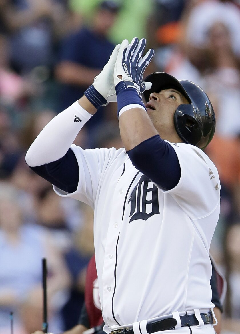 Detroit Tigers' Victor Martinez celebrates his solo home run against the Chicago White Sox during the third inning of a baseball game Friday, June 3, 2016, in Detroit. (AP Photo/Duane Burleson)