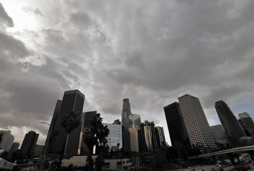 Clouds cover downtown Los Angeles on Friday morning. Though welcome, the rainfall may be the last before a long, dry summer.
