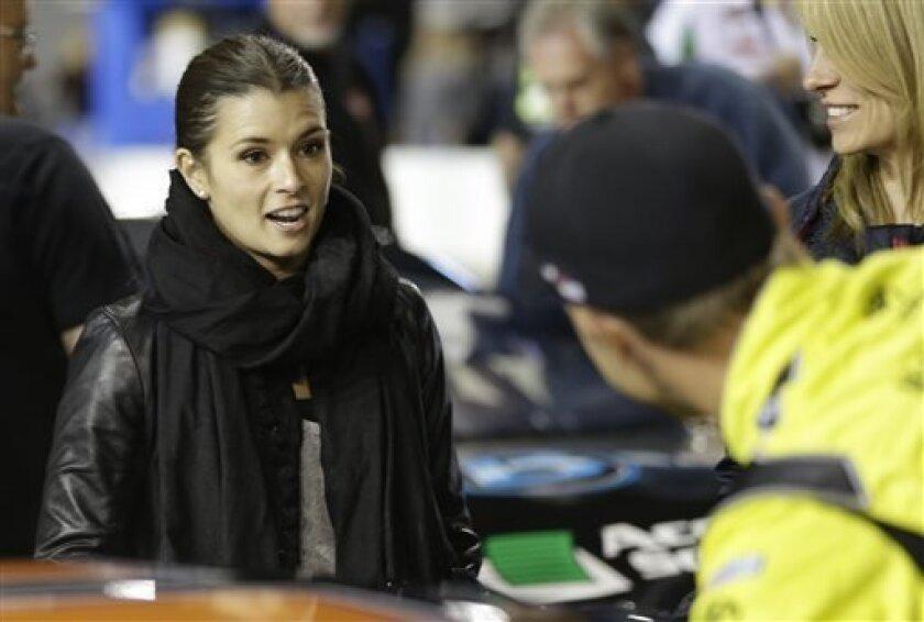 Danica Patrick, left, talks with Matt Kenseth before Denny Hamlin's charity race at Richmond International Raceway in Richmond, Va., Thursday, April 25, 2013. (AP Photo/Steve Helber)