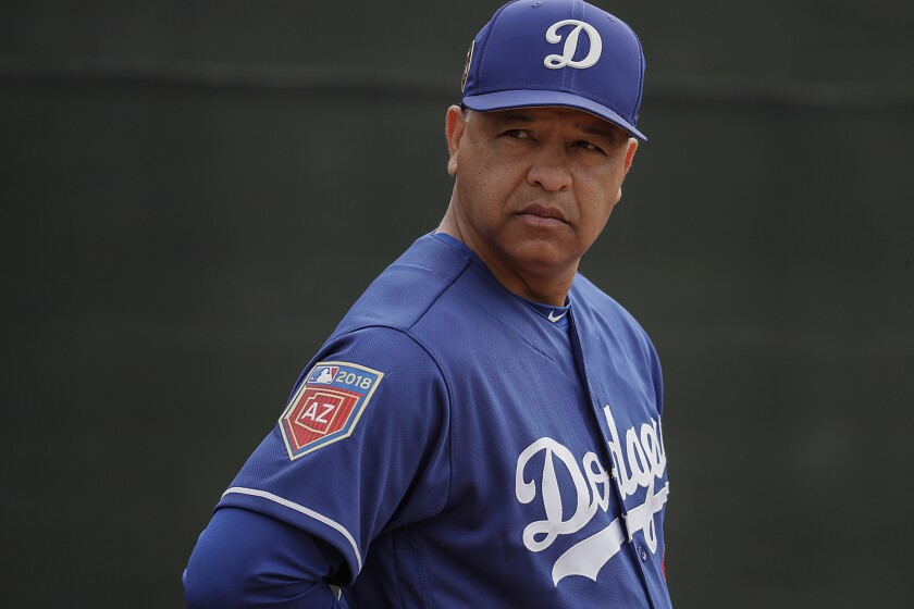 Dodgers manager Dave Roberts watches over a spring training workout at the Camelback Ranch complex in Phoenix.