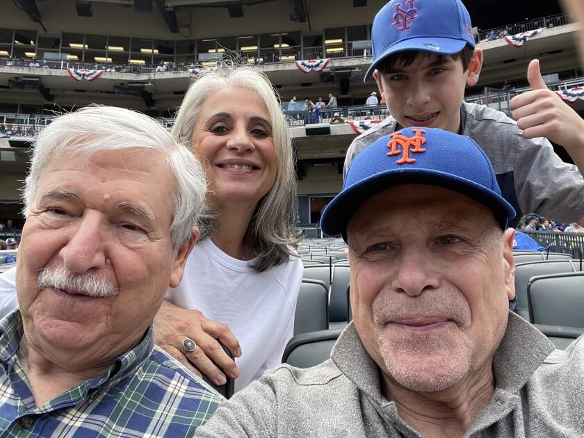 Returned Iran hostage John Limbert, left, Barbara Rosen, returned hostage Barry Rosen and Limbert's grandson Otto.