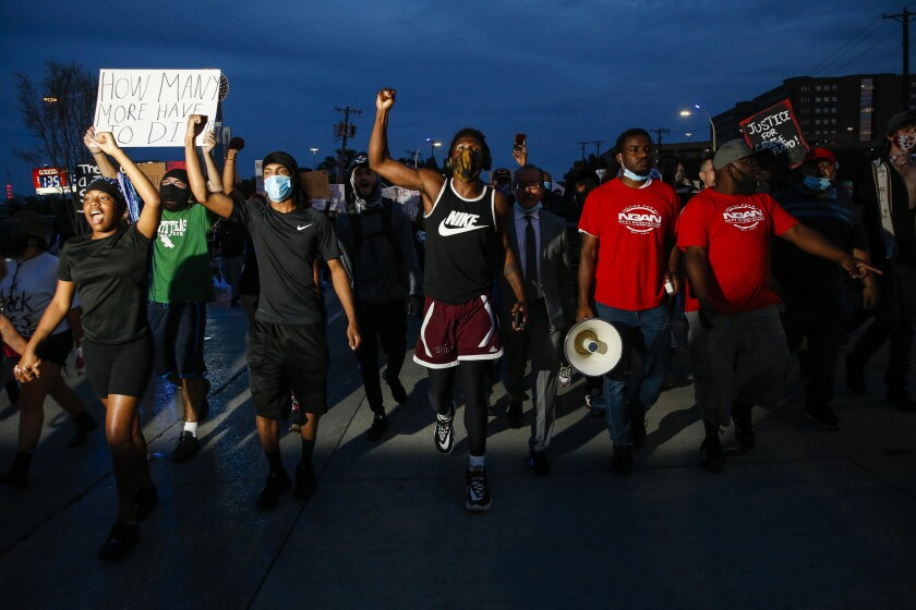 Protesters in Dallas march against police brutality on Monday.