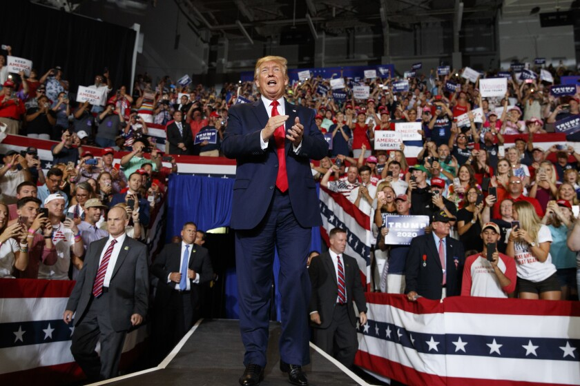 President Trump arrives to speak at a campaign rally July 17 at Williams Arena in Greenville, N.C.,