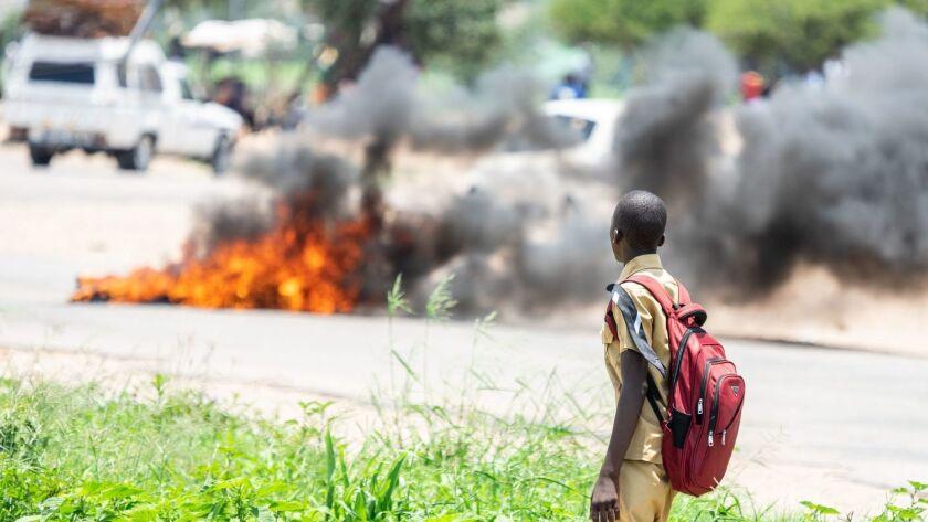 TOPSHOT-ZIMBABWE-ECONOMY-POLITICS-PROTEST-OIL