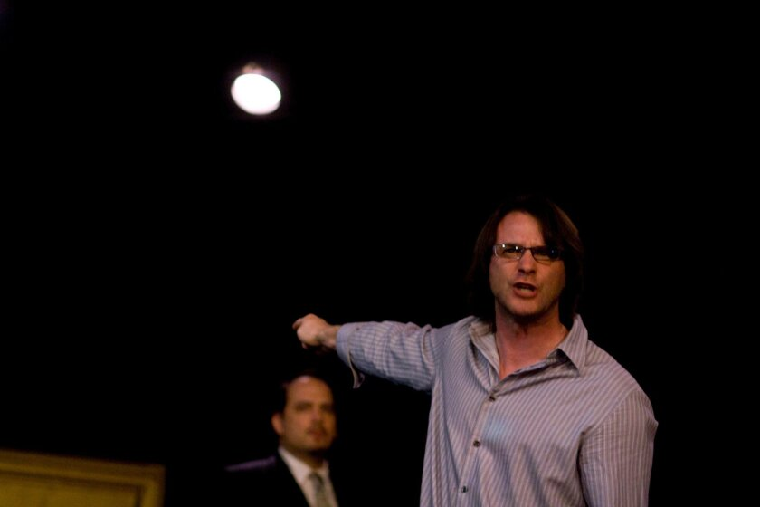 """The king (Sean Cox, front) rails against his rival, Bolingbroke (Jason D. Rennie), in Intrepid Shakespeare Co.'s """"Richard II."""""""