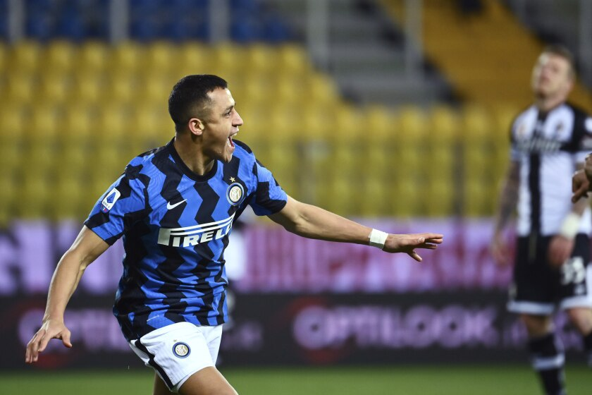 Inter's Alexis Sanchez celebrates after scoring during the Serie A soccer match between Parma and Inter Milan, at the Ennio Tardini Stadium in Parma, Italy, Thursday, March 4, 2021. (Massimo Paolone/LaPresse via AP)