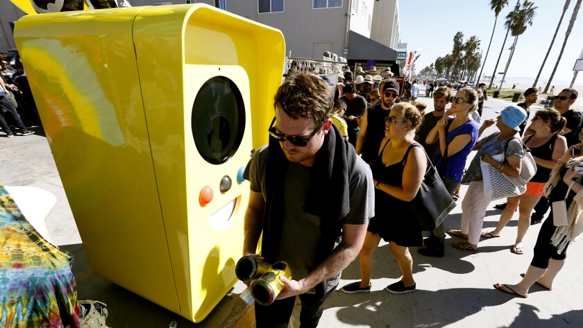 Snapchat Spectacles are dispensed from a bright yellow vending machine on the Venice Beach boardwalk Thursday.