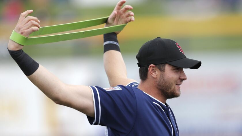 Padres catcher Austin Allen stretches before a spring training baseball game against the Seattle Mariners, Friday, Feb. 23, 2018, in Peoria, Ariz.