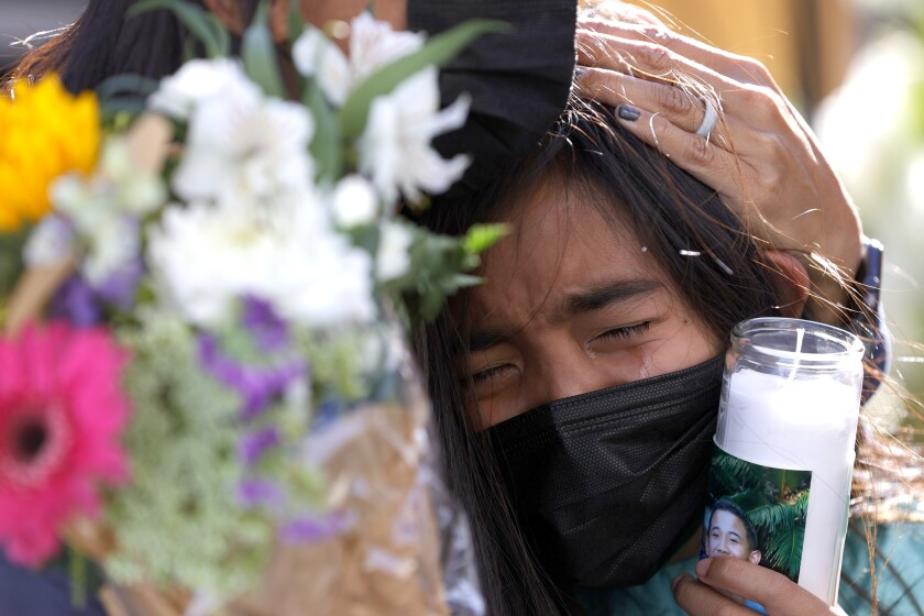 SAN JOSE, CALIFORNIA - MAY 27: A young mourner cries during a vigil for the nine victims of a shooting at the Santa Clara Valley Transportation Authority (VTA) light rail yard on May 27, 2021 in San Jose, California. Nine people were killed when a VTA employee opened fire at the VTA light rail yard during a shift change on Wednesday morning. (Photo by Justin Sullivan/Getty Images)