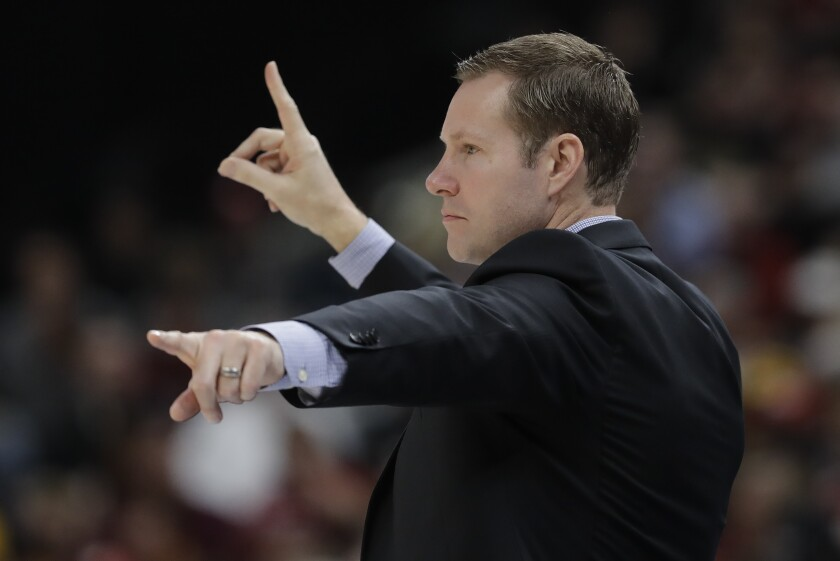 Nebraska coach Fred Hoiberg signals to his players.