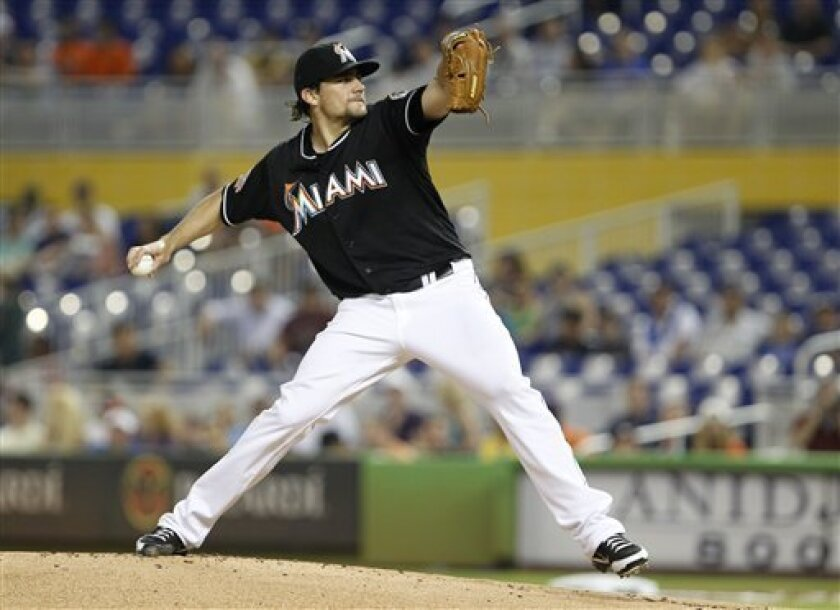 Miami Marlins' Nate Eovaldi delivers a pitch during the first inning of a baseball game against the New York Mets, Friday, Aug. 31, 2012 in Miami. (AP Photo/Wilfredo Lee)