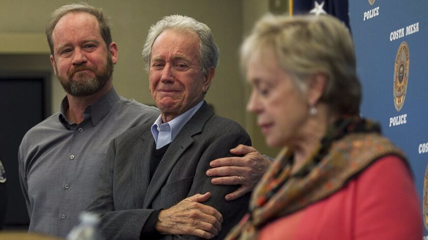 Scott Sudweeks, left, braces his father, Alan, as his mother, Sandy, speaks during a news conference Thursday to announce a suspect in the 1997 cold case rape and murder of Sunny Sudweeks.